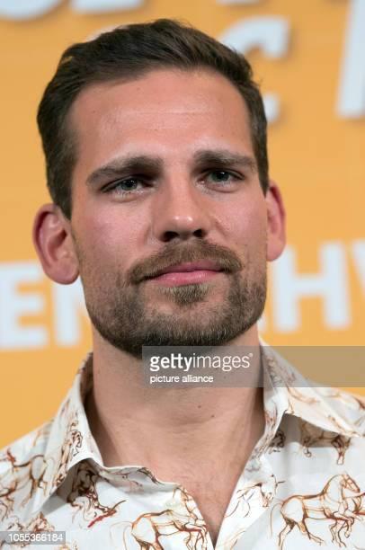 "October 2018, Saxony-Anhalt, Halle : The actor Moritz Otto comes to the cinema premiere of ""In aller Freundschaft - Die Krankenschwestern"" in the..."