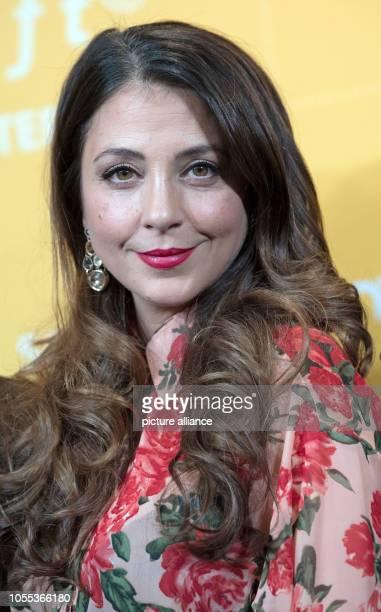 "October 2018, Saxony-Anhalt, Halle : The actress Arzu Bazman comes to the cinema premiere of ""In aller Freundschaft - Die Krankenschwestern"" in the..."