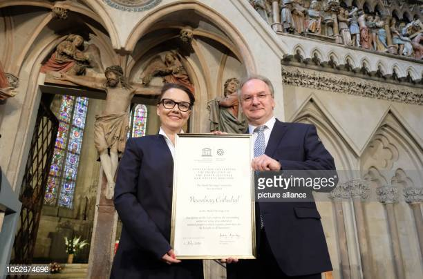 Michelle Müntefering State Secretary at the Federal Foreign Office and SaxonyAnhalt's Prime Minister Reiner Haseloff hold the World Heritage...