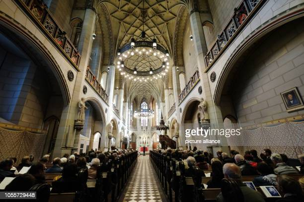 October 2018, Saxony-Anhalt, Wittenberg: Visitors of a church service gather in the castle church. Lutherstadt traditionally celebrates the...