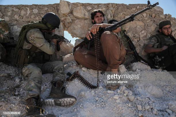Soldiers of the Sham Brigade of the National Liberation Front of Syria patrol the front line with forces loyal to Syrian President Assad in the Al...