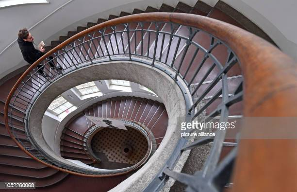A young man walks up the decorative staircase in the main building of the Bauhaus University Weimar Almost 100 years after the founding of the State...