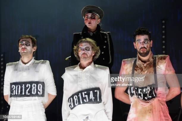 Marcus Horn Lutz Salzmann Dascha Trautwein and Nahuel Häfliger as Alex rehearsing a scene of the play A Clockwork Orange by ABurgess on the stage of...