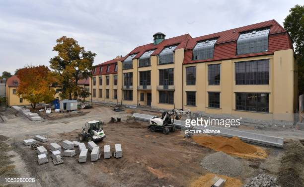 One construction site is the outdoor facilities in front of the main building of the Bauhaus University Weimar Almost 100 years after the founding of...