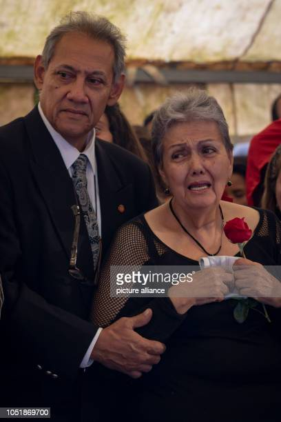Amparo Salazar mother of opposition councillor Fernando Alban cries at his funeral According to the Ministry of the Interior Alban had jumped out of...