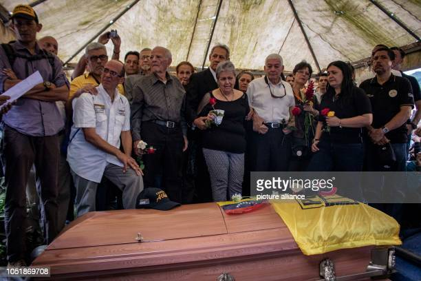 Amparo Salazar mother of the opposition councillor Fernando Alban cries at his funeral According to the Ministry of the Interior Alban had jumped out...