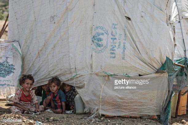 Internally displaced Yemeni children outside their family's hut One of the Arab world's poorest countries Yemen has been embroiled in a devastating...