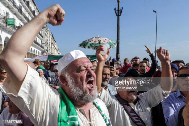 October 2019, Algeria, Algiers: Demonstrators shout slogans in front of police officers during a protest against a proposed new hydrocarbons law....