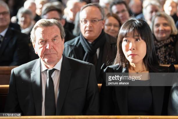 October 2019, Baden-Wuerttemberg, Schwäbisch Hall: Gerhard Schröder , former German Chancellor, and his wife Soyeon Kim are sitting in the Protestant...