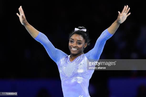 October 2019, Baden-Wuerttemberg, Stuttgart: Gymnastics: World Championships, apparatus finals, women: Simone Biles from the USA reacts after her...