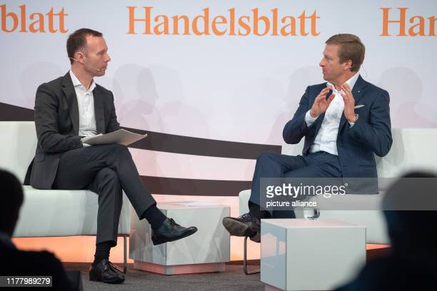 25 October 2019 BadenWuerttemberg Stuttgart Sven Afhüppe Chief Editor of Handelsblatt speaks with Oliver Zipse Chairman of the Board of Management of...