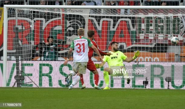 Soccer Bundesliga FC Augsburg Bayern Munich 8th matchday in the WWKArena Augsburg goalkeeper Tomas Koubek sees Munich's Thomas Müller miss a chance...