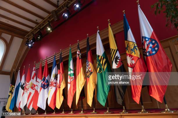 October 2019, Bavaria, Krün: The flags of the 16 federal states stand side by side in the meeting room of Schloss Elmau during the annual conference...