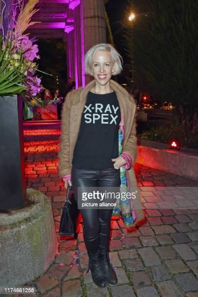 "October 2019, Bavaria, Munich: The author Katja Eichinger comes to the preview of the Vogue exhibition ""Ist das Mode oder kann das weg?"". The time..."
