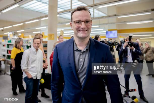 Jens Spahn Federal Minister of Health leaves the DHL delivery base smiling after his flu vaccination In addition to the Federal Minister of Health...