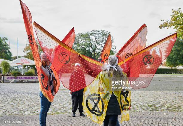 Participants of the protest camp of the climate protection movement Extinction Rebellion rehearse a performance not far from the Chancellery With...