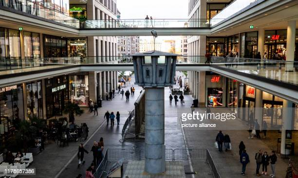 """October 2019, Berlin: The replica of a watchtower from the former inner-German border stands in the """"Mall of Berlin"""" shopping centre and commemorates..."""