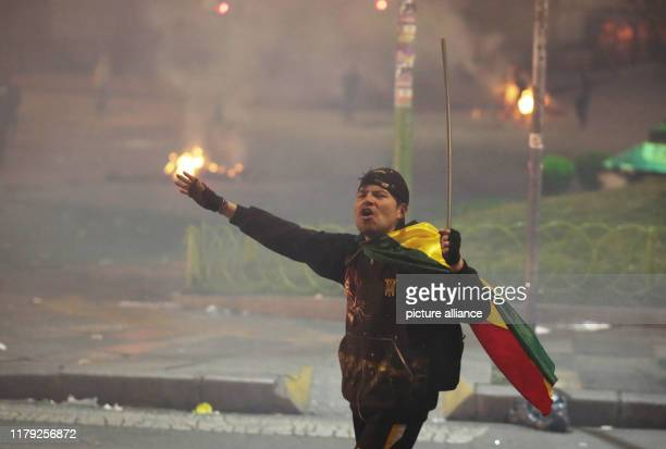 A demonstrator shouting slogans against President Morales during clashes Since the results of the presidential elections were announced President...