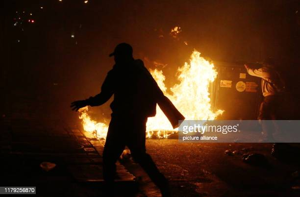 A demonstrator walks by a burning barricade during clashes in the Bolivian capital Since the results of the presidential elections were announced...