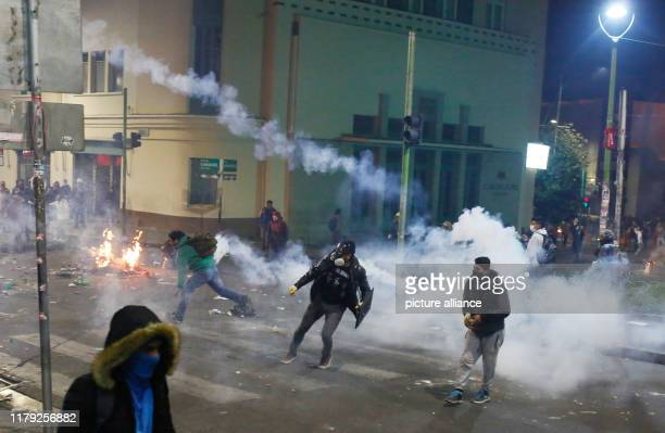 Demonstrator hurl tear gas canisters and stones towards police during clashes in the Bolivian capital Since the results of the presidential elections...