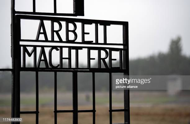 "October 2019, Brandenburg, Oranienburg: The lettering ""Arbeit macht frei"" stands at the entrance gate of the Sachsenhausen Memorial. At the beginning..."