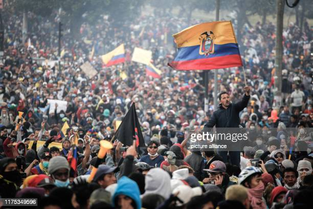 October 2019, Ecuador, Quito: Many people fly Ecuadorian flags in a massive protest against the government's economic policies. Indigenous peoples,...