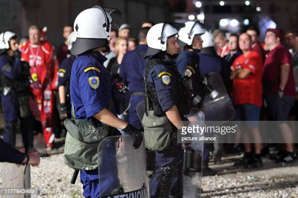 Greek policemen are guarding fans of FC Bayern Munich Around 80 stickarmed and hooded rioters interrupted FC Bayern Munich's 40 victory over...