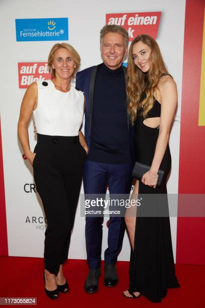 Jörg Pilawa presenter his wife Irina and daughter Emmy Pilawa come to the evening gala Heroes of everyday life of the programme magazine at a glance...
