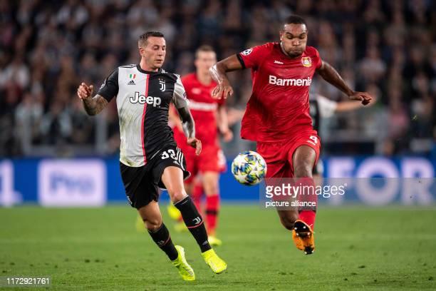 Soccer Champions League Juventus Turin Bayer Leverkusen Group stage Group D Matchday 2 Turins Federico Bernardeschi and Leverkusen's Jonathan Tah...