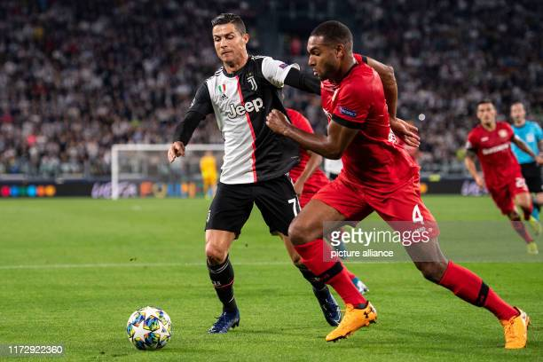 Soccer Champions League Juventus Turin Bayer Leverkusen Group stage Group D Matchday 2 Leverkusen's Jonathan Tah and Turin's Christiano Ronaldo fight...