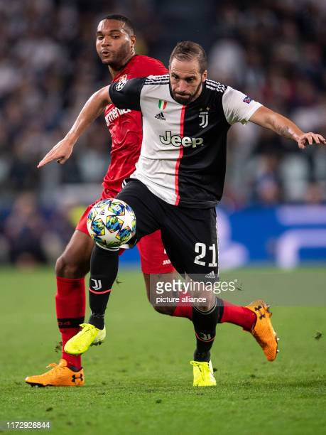 Soccer Champions League Juventus Turin Bayer Leverkusen Group stage Group D Matchday 2 Leverkusen's Jonathan Tah and Turin's Gonzalo Higuain fight...