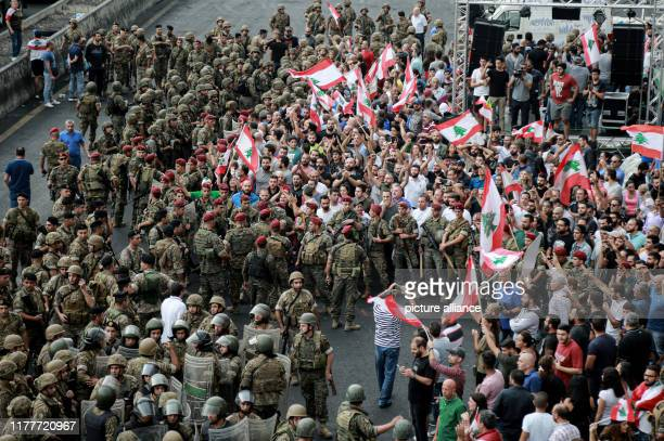 October 2019, Lebanon, Jal El Dib: Lebanese army soldiers surround demonstrators during an attempt to reopen the highway and remove protesters at the...