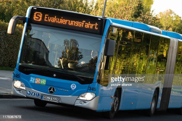 """October 2019, Lower Saxony, Göttingen: A bus of the Göttinger Verkehrsbetriebe with the announcement """"Evakuierungsfahrt"""" is on its way during an..."""