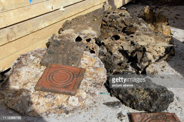 October 2019, Lower Saxony, Göttingen: Remains of tin barrels, slag and clay bricks, which were found on a heap in the ground and were originally...