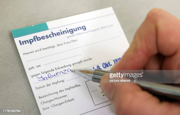 10 October 2019 MecklenburgWestern Pomerania Rostock In the health department an employee fills out a vaccination certificate for the flu vaccination...