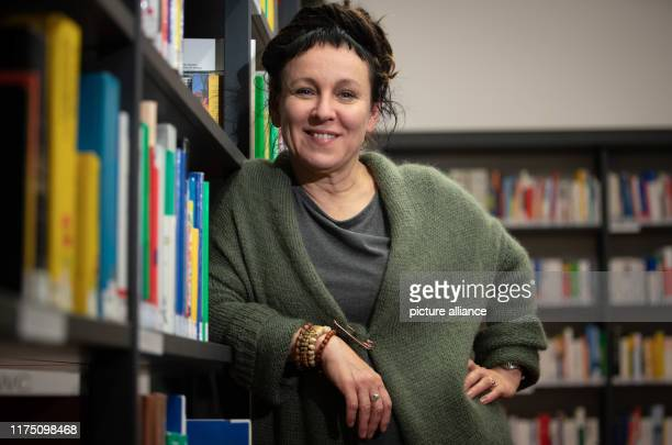 10 October 2019 North RhineWestphalia Bielefeld Polish author Olga Tokarczuk is standing at a bookshelf in the runup to a reading The Swedish Academy...