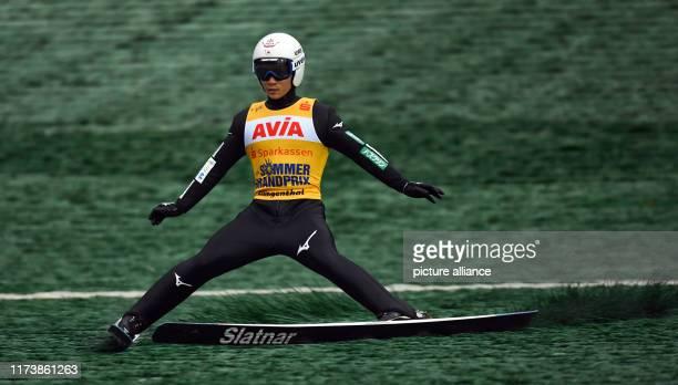 October 2019, Saxony, Klingenthal: Nordic skiing / ski jumping: Summer Grand Prix, men, at the Vogtland Arena in Klingenthal. Yukiya Sato from Japan...