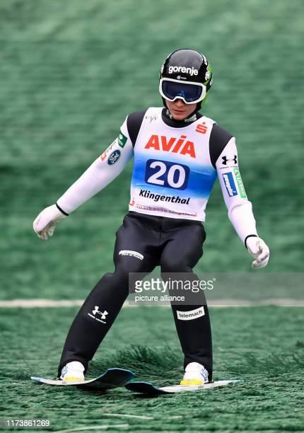 October 2019, Saxony, Klingenthal: Nordic skiing / ski jumping: Summer Grand Prix, men, at the Vogtland Arena in Klingenthal. Anze Lanisek from...
