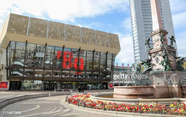 """October 2019, Saxony, Leipzig: An oversized """"89"""" hangs on the glass facade of the Gewandhaus. Numerous events in Leipzig commemorate the major..."""