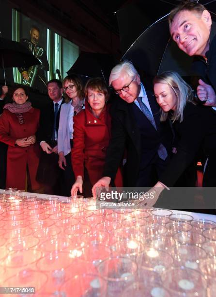 Burkhard Jung Lord Mayor of the City of Leipzig and his wife Ayleena Jung and Federal President FrankWalter Steinmeier with his wife Elke Büdenbender...