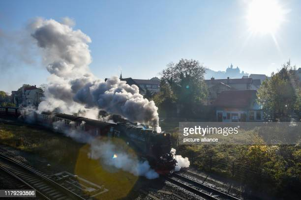 30 October 2019 SaxonyAnhalt Wernigerode A steam locomotive of the Harzer Schmalspurbahnen leaves the station Wernigerode In the background you can...
