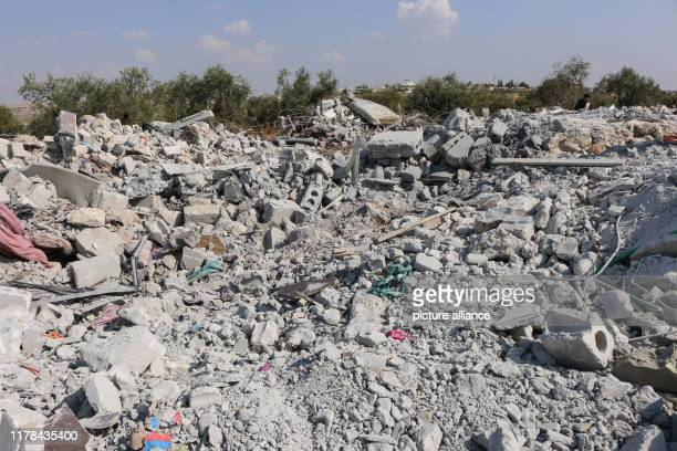 A general view of the debris of a house following an alleged USled raid at the northwestern Syrian village of Barisha in the province of Idlib near...