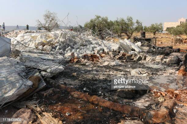 Syrians inspect the debris of a house following an alleged USled raid at the northwestern Syrian village of Barisha in the province of Idlib near the...