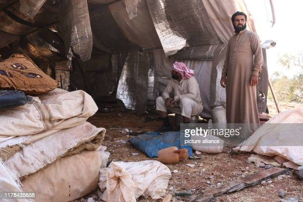 October 2019, Syria, Barisha: Syrians inspect their tent following an alleged US-led raid at the northwestern Syrian village of Barisha in the...