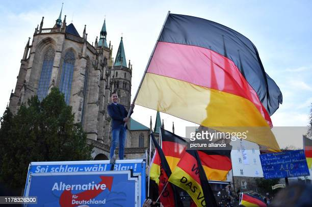 October 2019, Thuringia, Erfurt: Supporters of AfD Thuringia waving flags at the end of the election campaign of AfD Thuringia. On 27 October, a new...