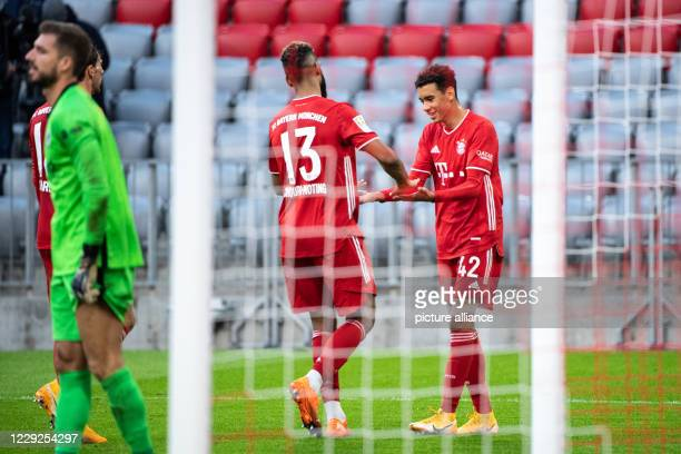 Football Bundesliga Bayern Munich Eintracht Frankfurt 5th matchday in the Allianz Arena Eric Maxim ChoupoMoting and goal scorer Jamals Musiala from...