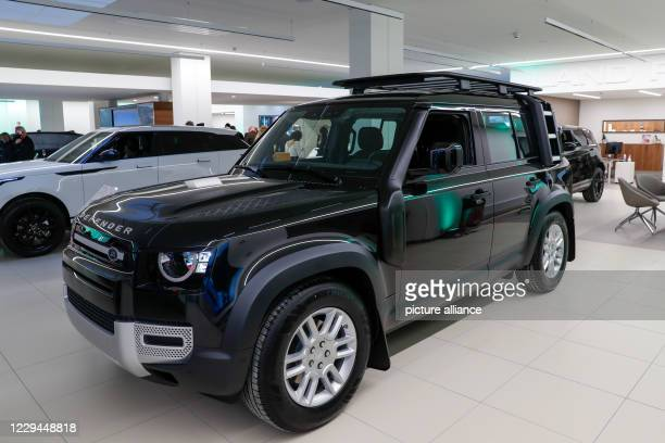 """October 2020, Berlin: A Land Rover Defender is on display at the showroom opening of the """"Land Rover and Jaguar"""" brands at the Dinnebier dealership...."""