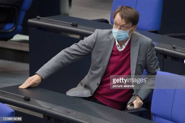 """October 2020, Berlin: Karl Lauterbach comes to a session of the German Bundestag and takes a seat on a chair. The budget for """"Justice and Consumer..."""