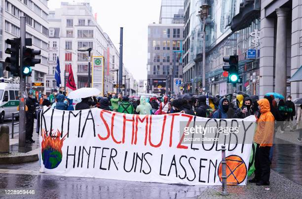 "October 2020, Berlin: ""Leave the climate protection lobby behind us"" is written on the banner of the climate protection group Extinction Rebellion...."