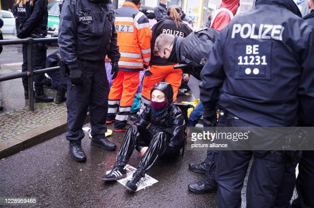 October 2020, Berlin: Police officers are asking an activist from the climate protection group Extinction Rebellion to leave. The activists occupy...